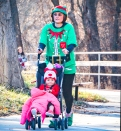 Jacquelyn and Blaklee Fischer stroll toward the finish at the MCH Ugly Sweater 5Krun/2 mile walk.