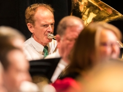 Jeff Mount sits in with the Tuba section during the Holiday Concert presented by the Blair Community Band Sunday in the Blair High School Auditorium. Mount is the director of the Blair Area Community Band.