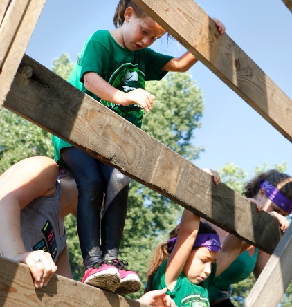 From left, Abbigail Schakat and Kylie Campos carefully climb down the wooden ladder obstacle. Washington County Fair Saturday AM