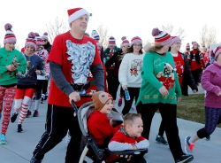 Ryan Fischer with Braxson Beaty and son Rhett Fischer and more than 125 participants took part in the MCH 5K Run/2 Mile Walk Sunday afternoon.