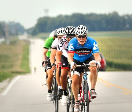 Micheal O'Dea leads a pack of riders along CR 15 north of highway 30 Sunday Morning. Around 60 riders participated in the Wear Yellow Nebraska benefit ride. WCF Sunday bike ride