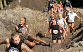 Madyson Ray followed by Hannah Hicks and Sandy Eckert slog through muddy trenches. Washington County Fair Saturday AM