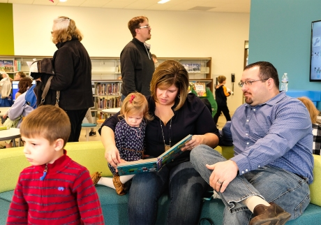 Wyatt Wemhoff with sister Gwen and parents Amy and Nick check out the childrens reading and play ares in the new library. Ribbon Cutting Blair Library Grand Opening