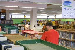 Volunteers prepare book carts for the move