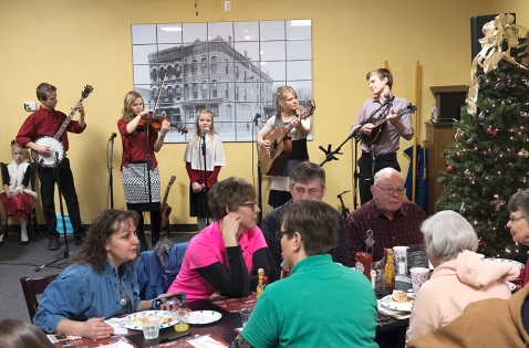 Stangl Family singers perform at the Christmas for the Coat breakfast at Fernando's Cafe and Cantina Wednesday morning.