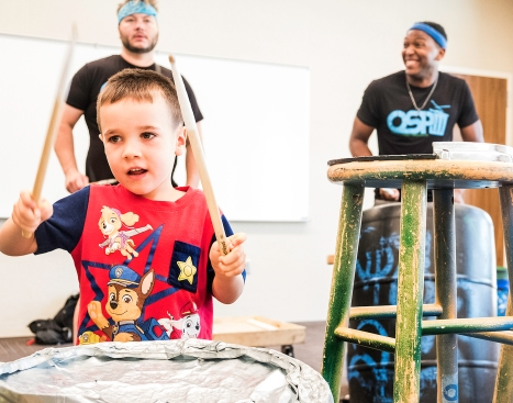 Will Bacon keeps the beat with the Omaha Street Percussion at Blair Library and Technology Center Tuesday morning.