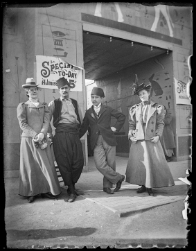 Fair goers pose at an entrance to the Exposition.