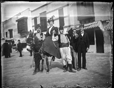 Fair goers pose with a mule along the Streets of Cairo.
