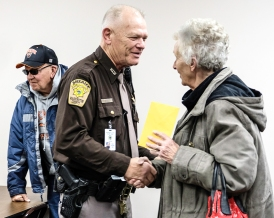 Trudy Truhlsen shakes hands with retiring Deputy Fred Carritt