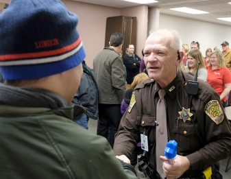 Deputy Fred Carritt greets friends and community members at his retirement reception.