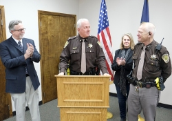 Washington County Sheriff Mike Robinson, center, honors Deputy Fred Caritt during a reception for the deputy who was retire after 45 yers in law enforcement. Also pictured are Chief Deputy Kevin Willis and Carritt's wife, Marla.