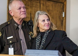 Washington County Sheriff's Deputy Fred Carritt and wife Marla watch a slide show during a reception honoring carrot on his retirement.