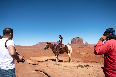 Woman poses on horse, Monument Valley, Navajo Tribal Park, Utah
