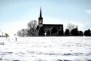 Blowing and drifting snow Sunday covered and pretty much closed down County Road 9 near St. Paul's Lutheran Church north of Arlington